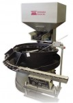 Cap feeder with linex and noise reduction