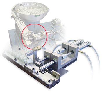 Inline vibratory feeder hold and release escapement, spring loaded.