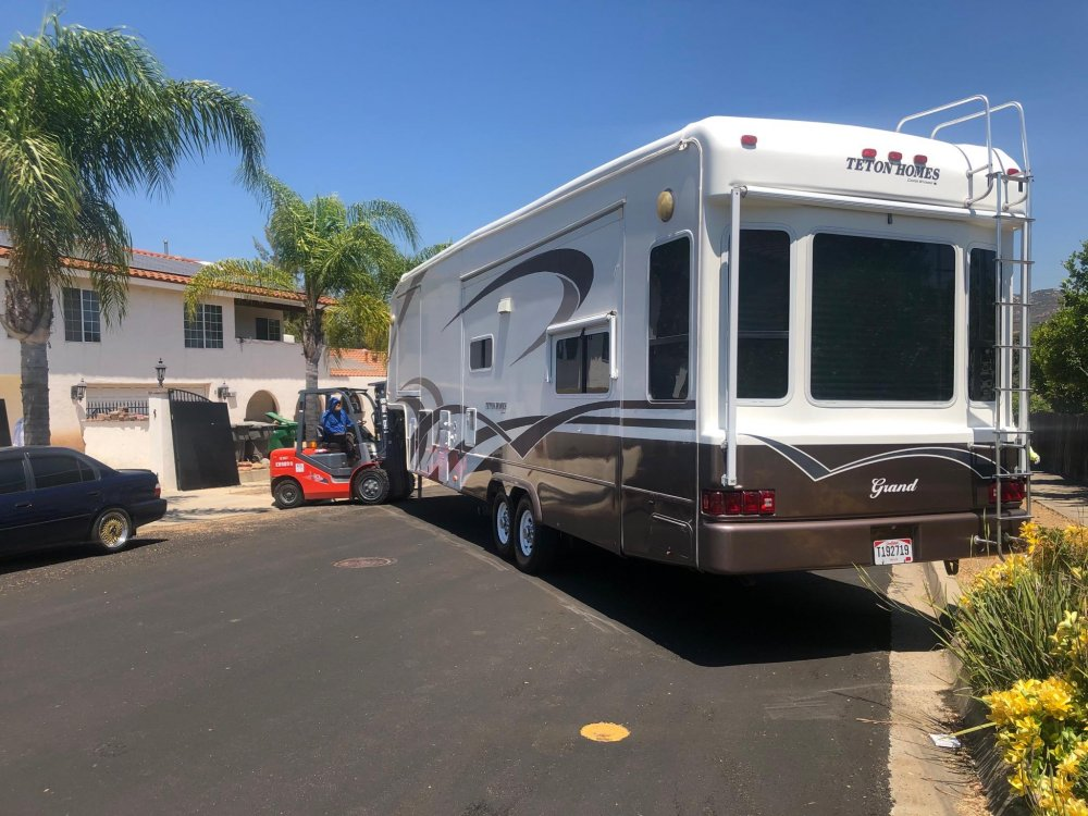 Customer used their 5th Wheel Fork Rhino to shoe-horn their RV next to their home for a one time move